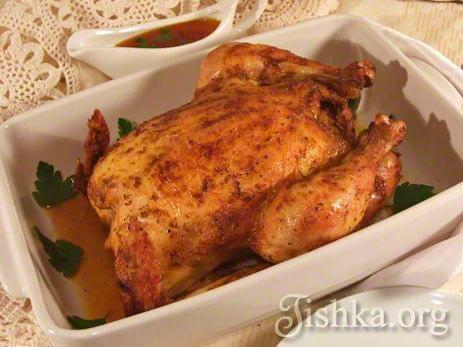 Как вкусно зажарить курицу в духовке в рукаве